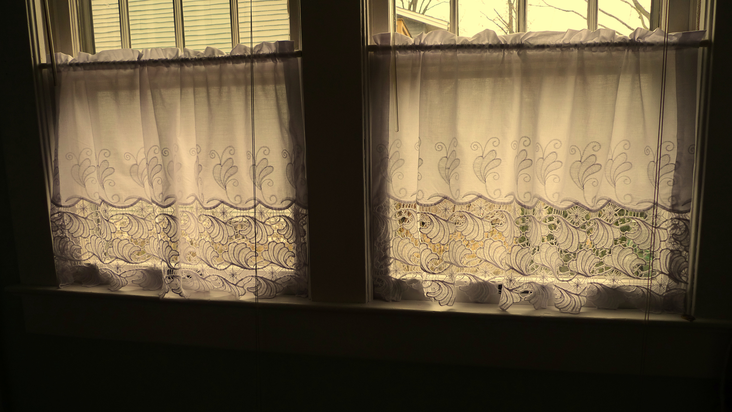 "And as cooler weather approaches, consider dressing your home's windows, to buffer chilling winds and glass.  Our interchangeable ""curtains,"" photo'd above, on easily removable spring-tension rods, allow for quick changes of fabric treatments.  Prices start @ $15/window."