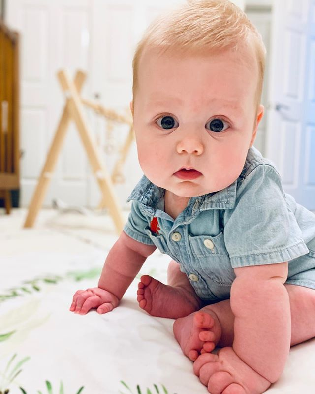 Five months. My big-eyed cutie pie has started rolling to his tummy by himself, touching our faces, is sleeping through the night (thank you, @takingcarababies!), can sit up—with a little help, sucks his hands all day and can finally reach his toes! #judeellington