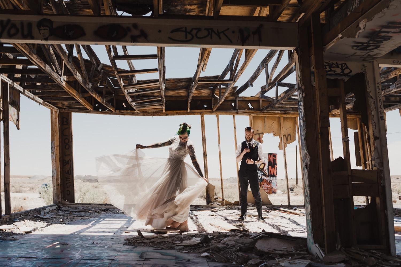 54_0447Kaylah_Jeff_Desert_Elopement_green_tattoos_Desert_dress_pink_hair_elopement_wedding.jpg