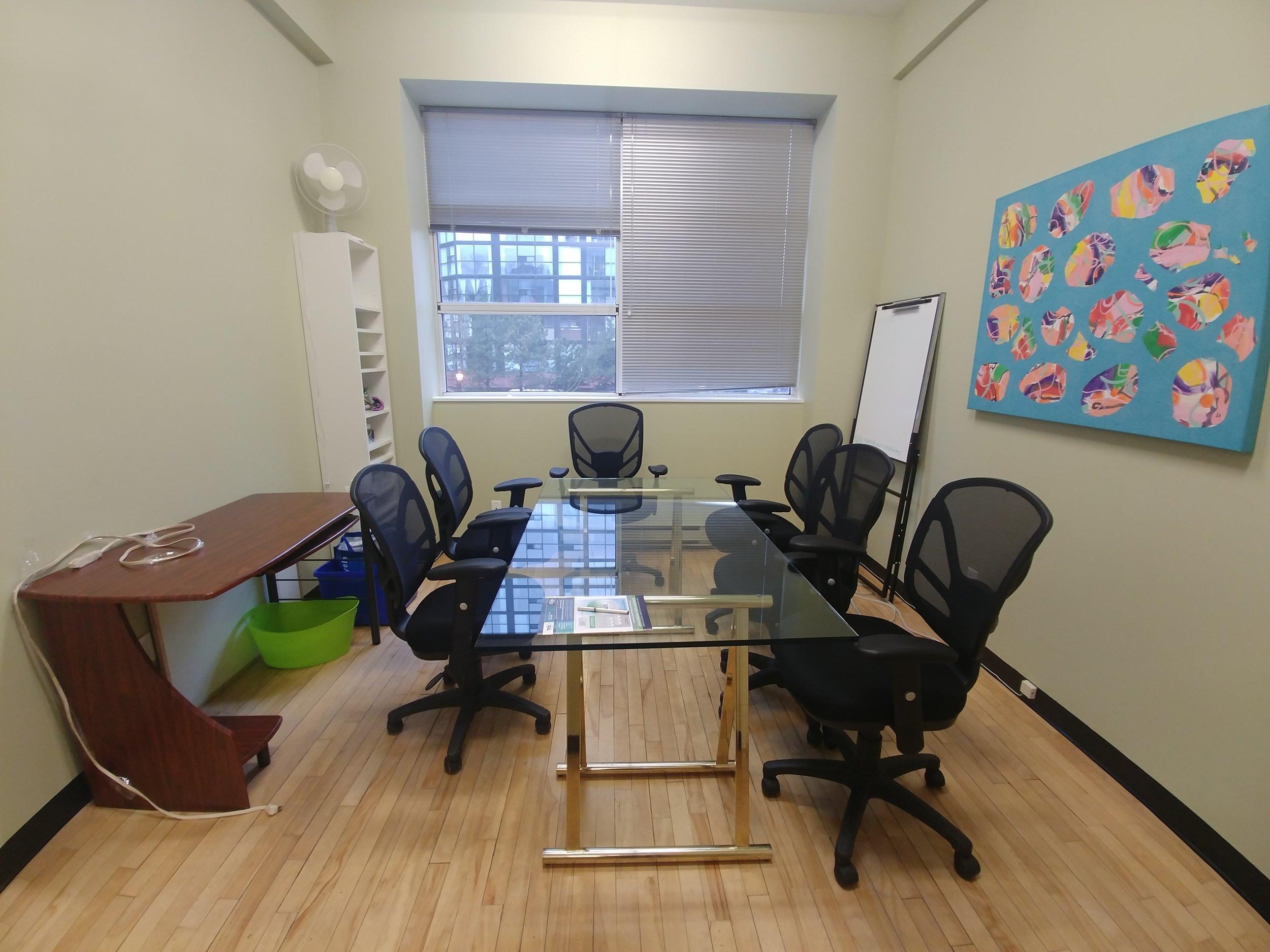 8-person capacity boardroom. west-facing window.