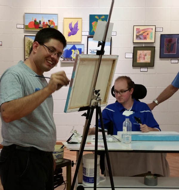 Tony (left) painting with his friend Nate at Visions Revealed 2016