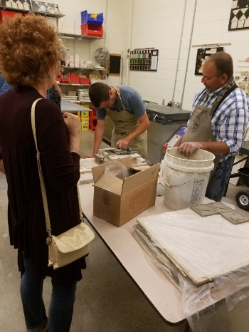 AOS artist Mark Straka, demonstrating tile production with Ceramics Director Bill Young.