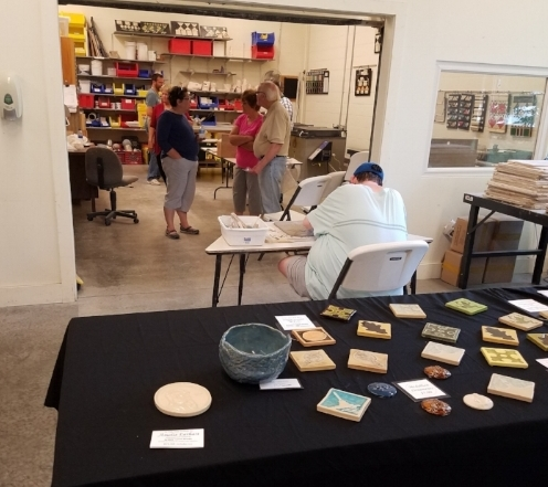 A view of the ceramics studio and a selection of tile products on display.