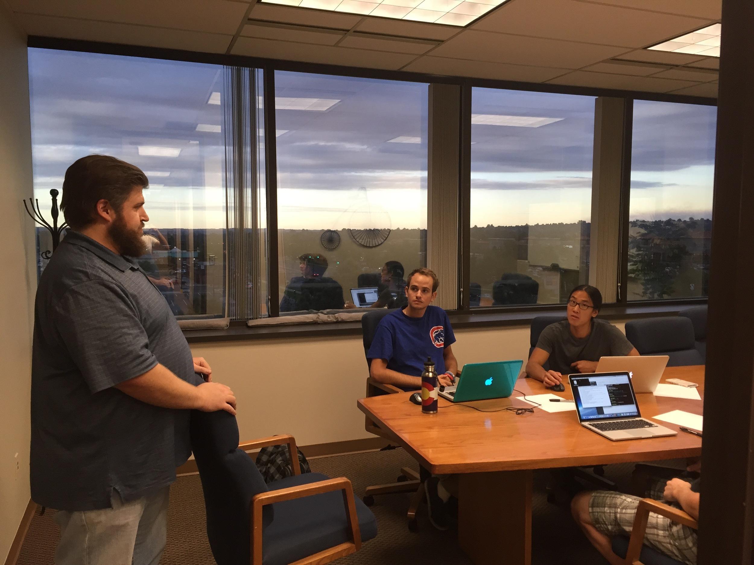 DaVinci Coders Senior Ruby on Rails Instructor, Jason Noble, advising a posse of student developers
