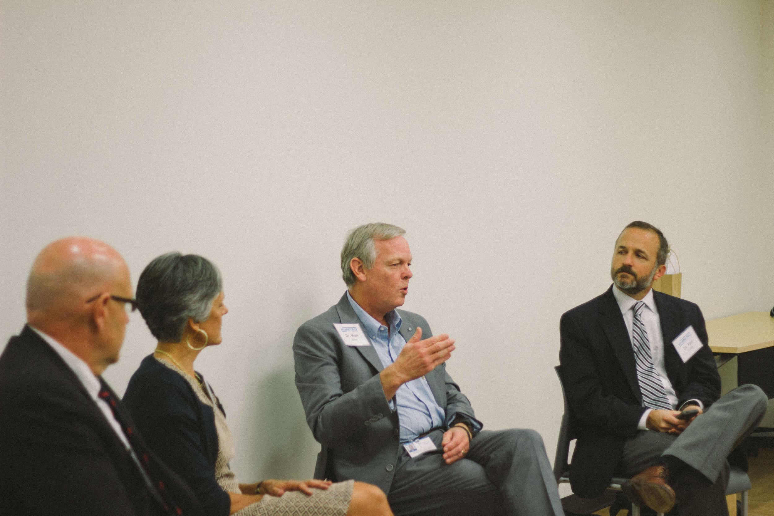 """Drs. John Thorp, Joan Perry, Mark Miller, and Farr Curlin on panel titled """"Medicine as Christian Vocation?""""."""