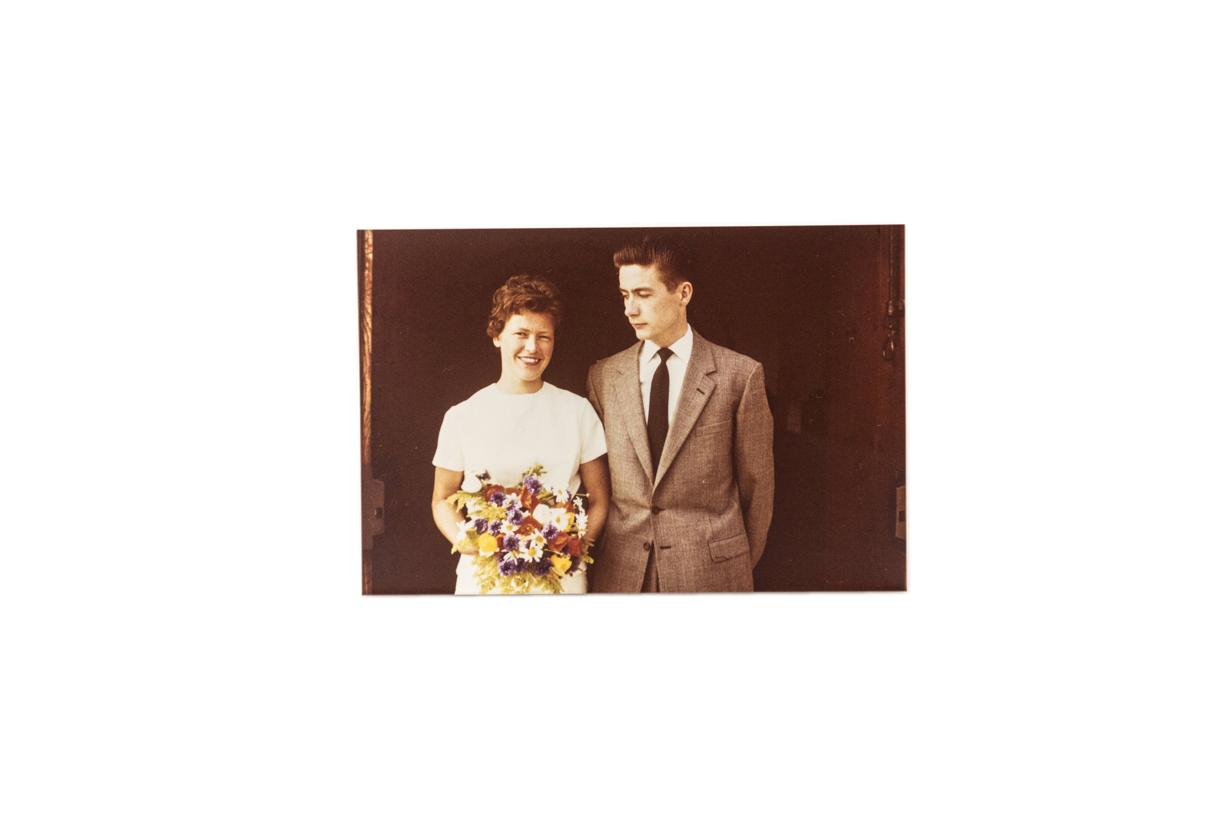 "Wedding, July 1, 1961.   ""Poul was in Copenhagen and I was in Randers. So, we met in Aarhus Saturday noon and got married Saturday afternoon. The pastor escorted us to the alter. There wasn't even any organ music. It was a small wedding."""