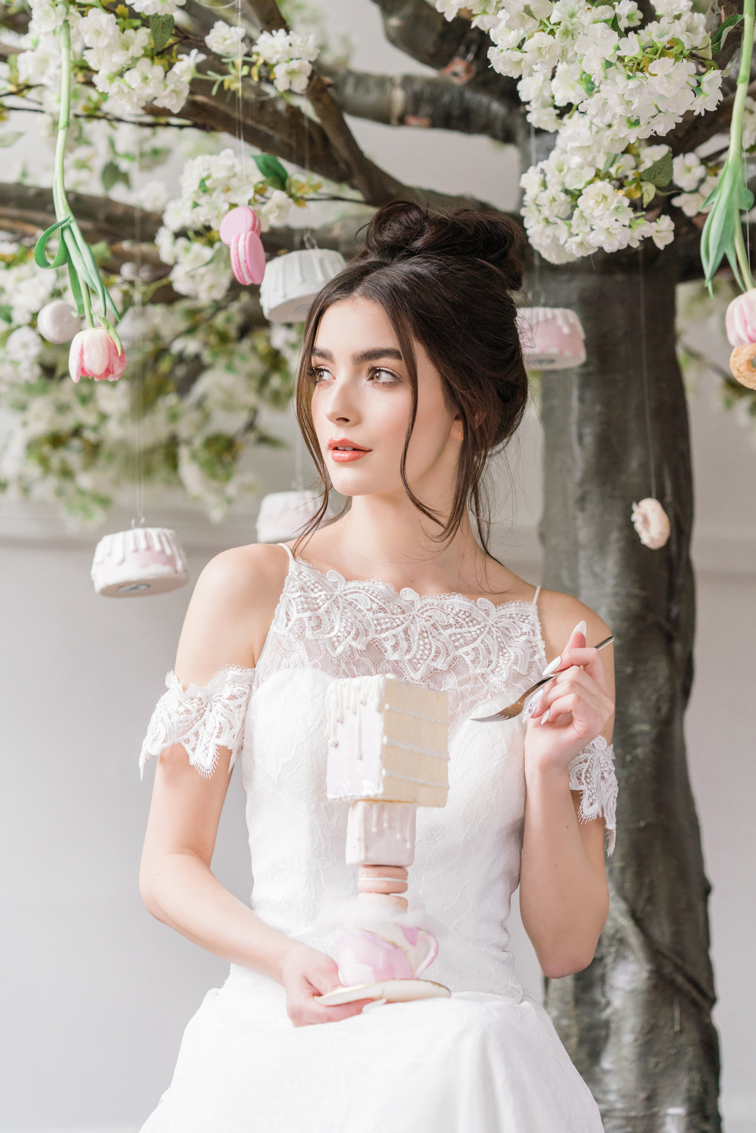 August In Bloom - Fantasy bride holding cake - Serene Dream (Wedluxe)