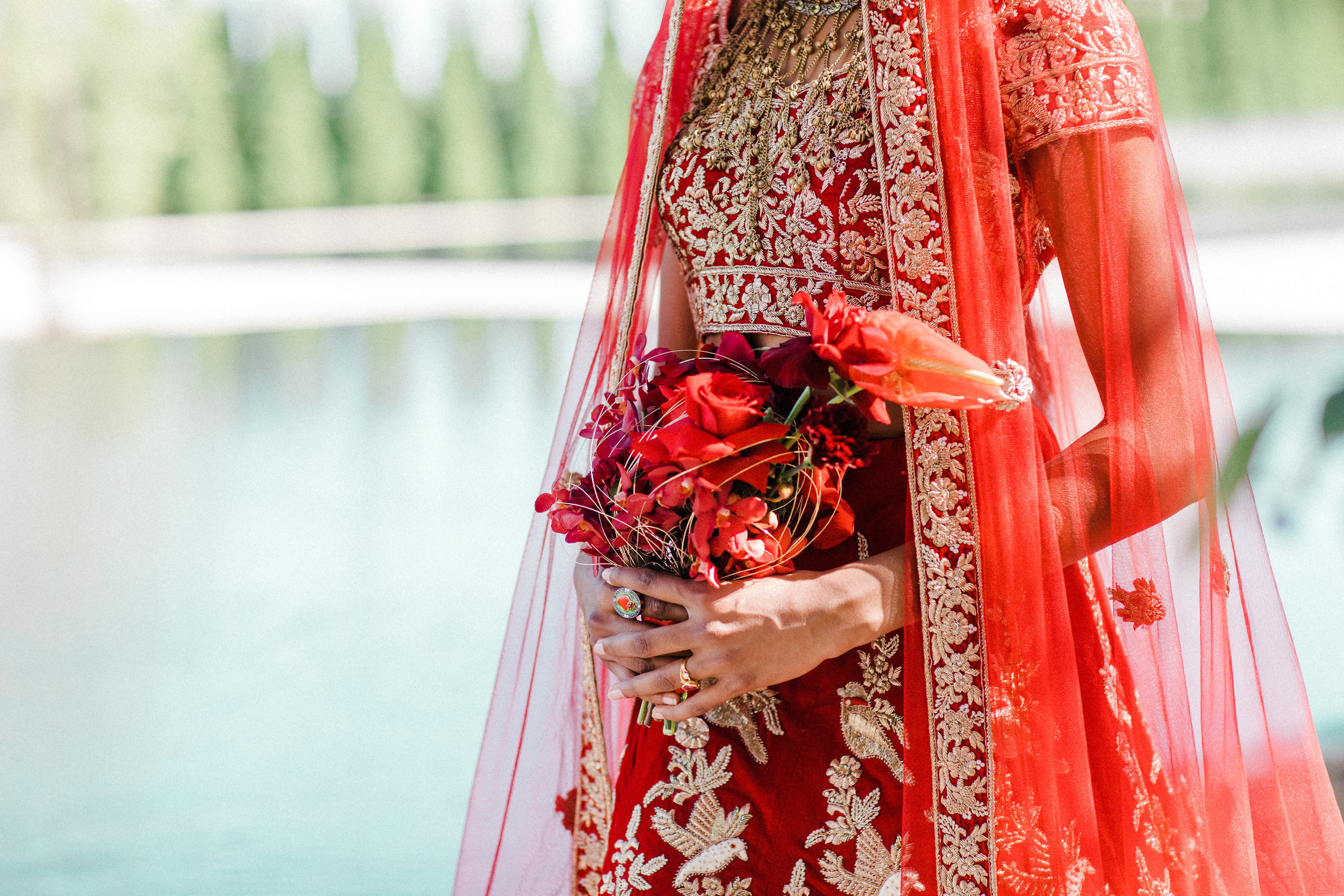 August In Bloom - Bride holding bouquet - Scarlet Sweetheart (Lavish Dulhan)