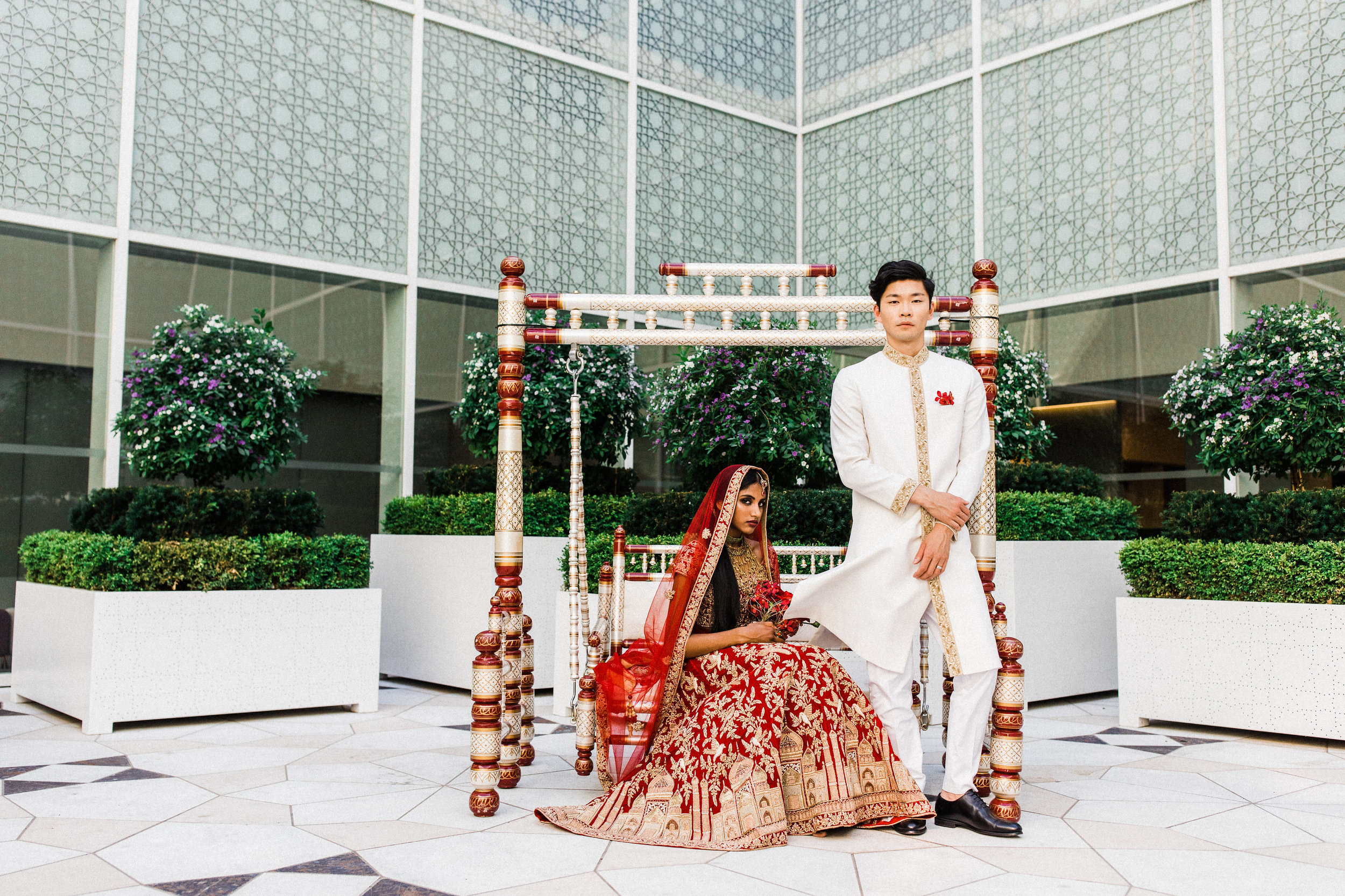 August In Bloom - Bride and groom at ceremony - Scarlet Sweetheart (Lavish Dulhan)