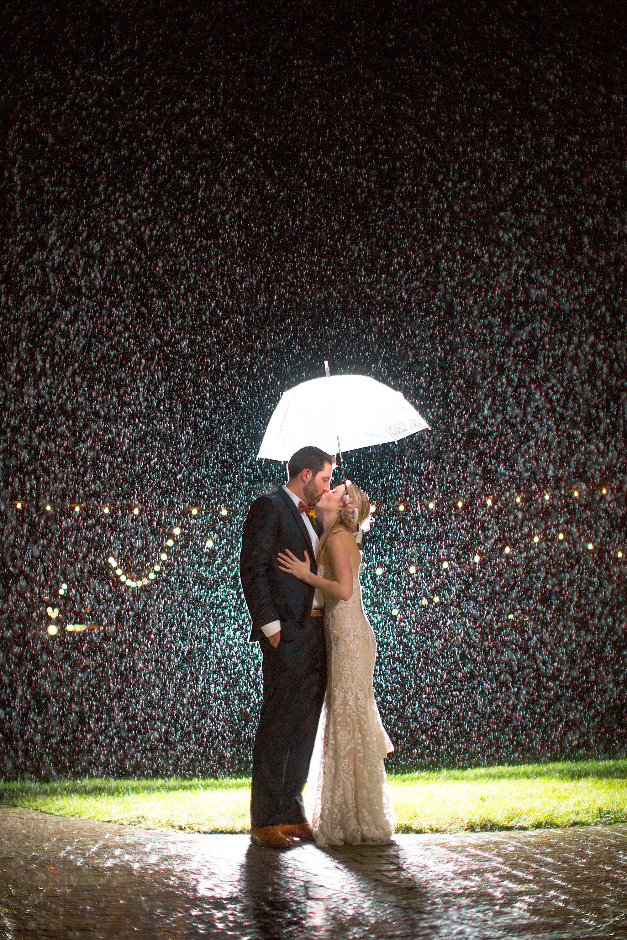 """I love this photo. And it's gone a bit """"viral"""" sure. But what excites me about this photo is the couple. I remember talking to them during our consultation about chipotle and the redskins. I look at this image and think about how willing they were to let me try something different and how awesome they were about the torrential downpour on their wedding day."""