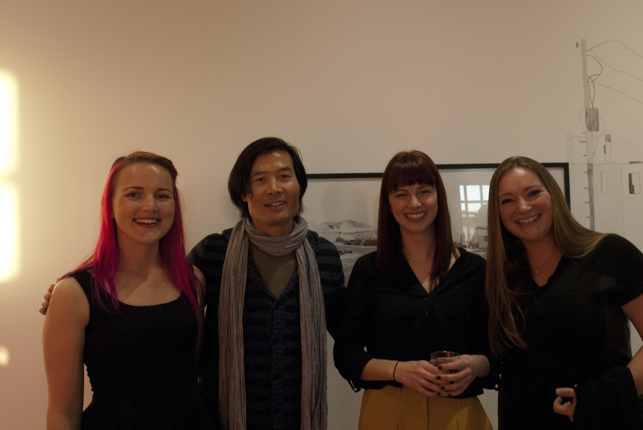 The Embark Gallery team, Carolyn Nickell, Angelica Jardini and Tania Houtzager, share a laugh with juror for the exhibition and esteemed artist, Michael Zheng.