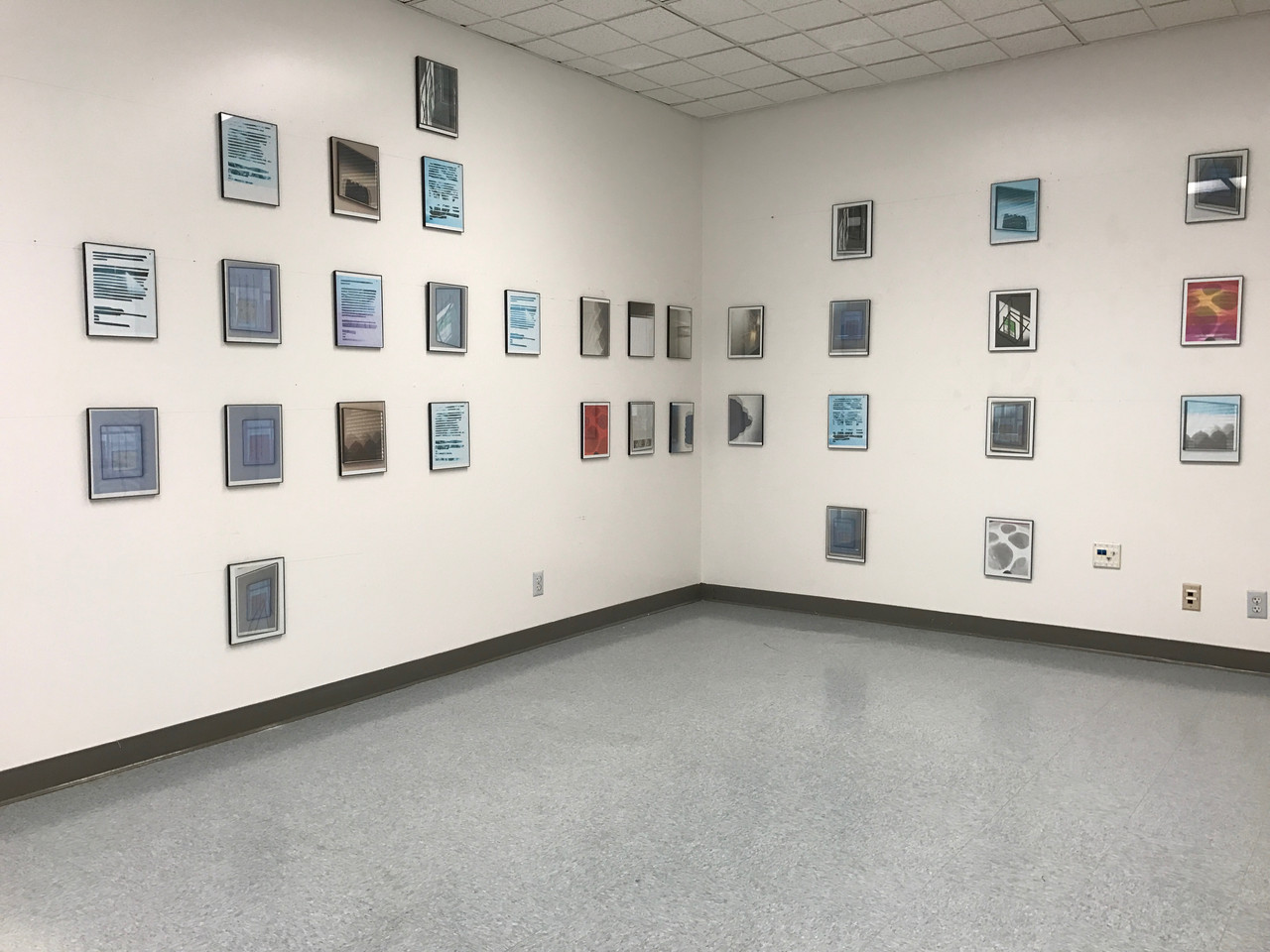 Amy Cella. Installation view of Search and Destroy, Just Be Careful in the Corner and You Move Fast, I Count Slow, 2017. Inkjet prints in 33 black plastic frames.