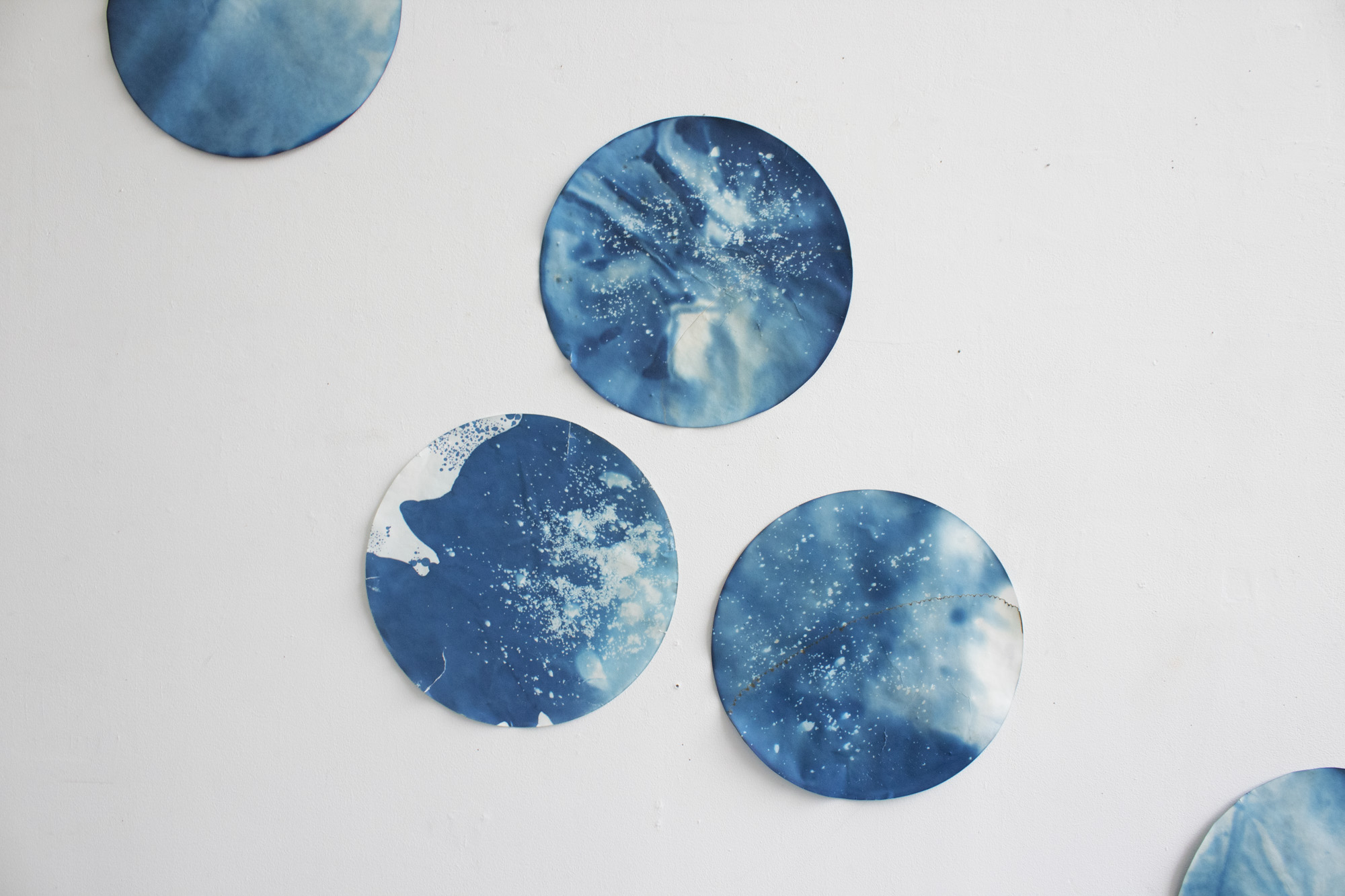 Hannah Perrine Mode.  Europa (pouring in from Taurus) , 2018. Ice (Oakland tap water, Antarctic ice core samples, Juneau Icefield glacier water) and cyanotype on filter paper. Detail.