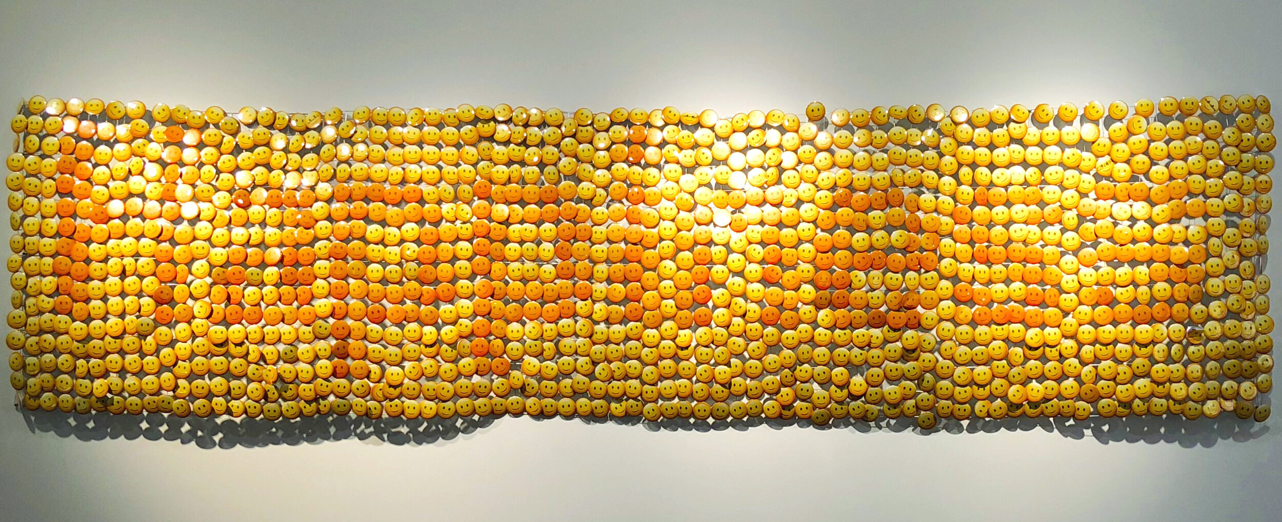 Yourong Zhao.  Happiness To Go , 2018. Souvenir pins on wire.