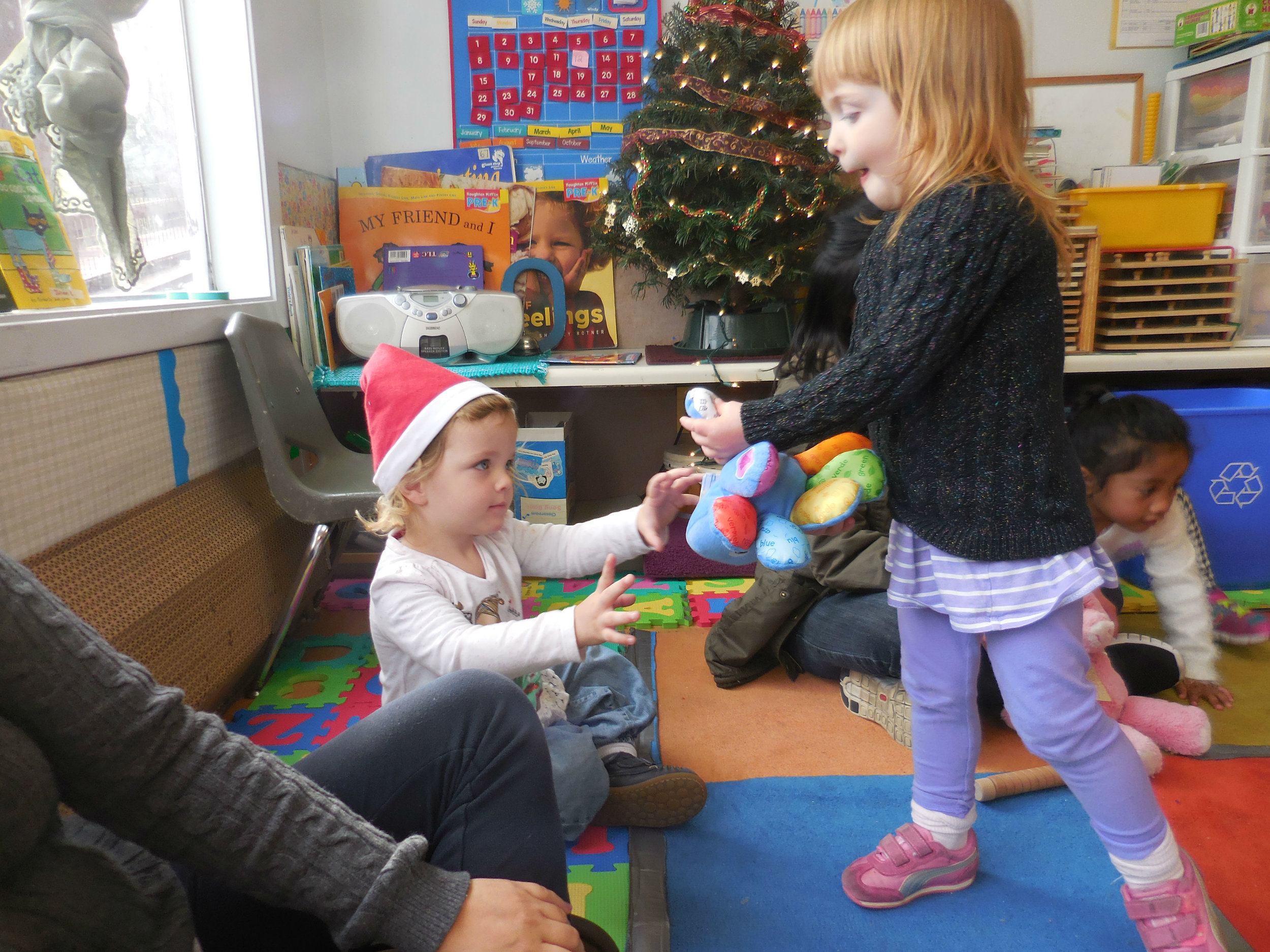 Two children sharing their favorite stuffies!#.jpg