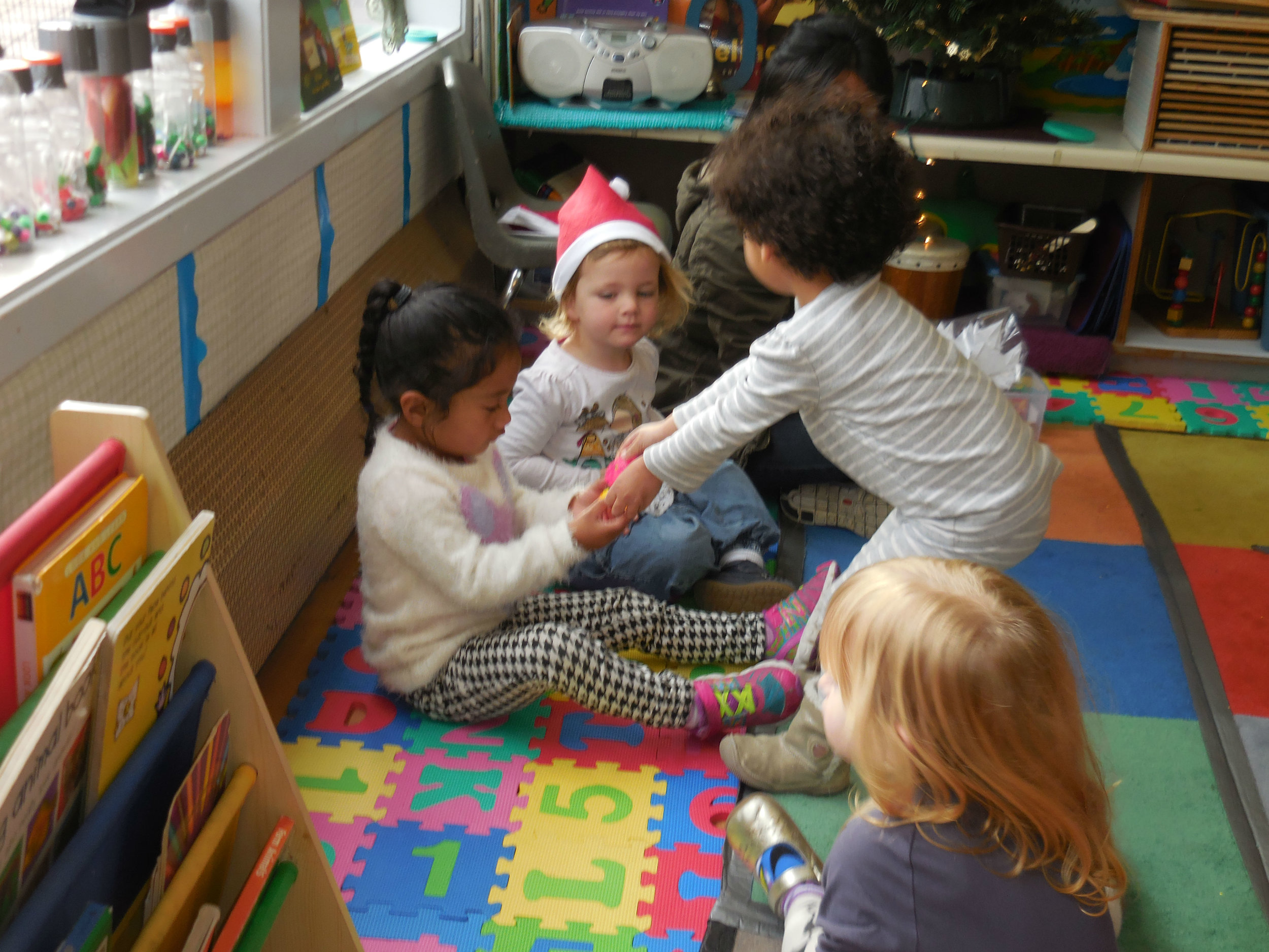 Handing their toys to one another to share!#.jpg