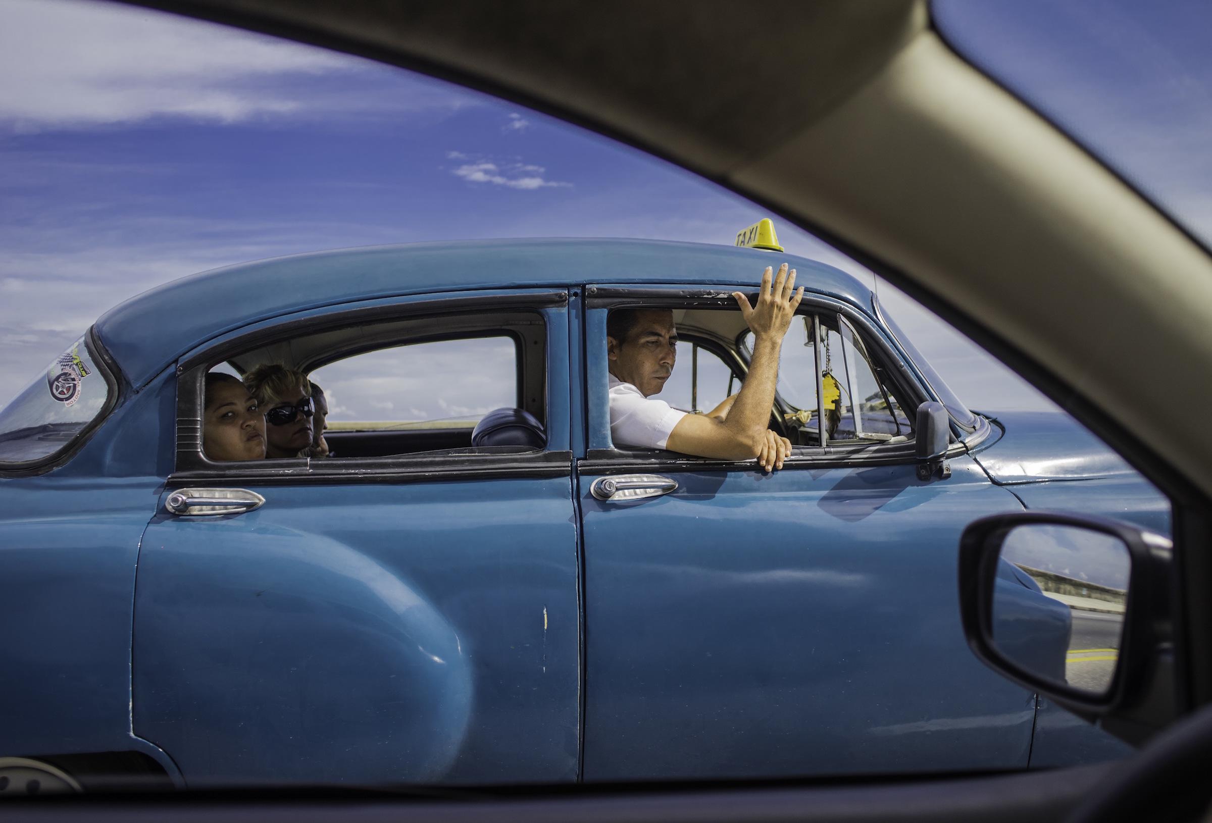 Family in Blue car.jpg