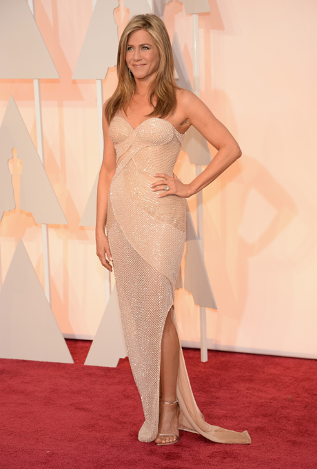 Jennifer Aniston in Versace:  Panels of nude beadwork swirl across the sweetheart neckline. The sheer fabric keeps it sexy and glamorous. This would be perfect for a city skyline rooftop cocktail party or reception gown. No accessories needed as the heavy bead work does all the talking!