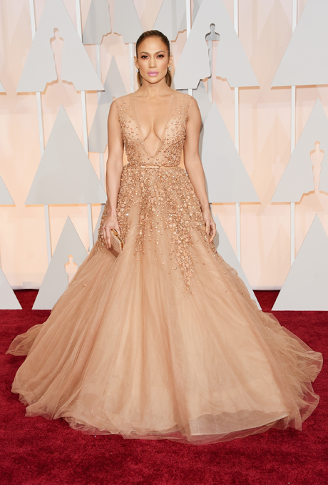 Jennifer Lopez in Elie Saab:  This gown is sexy and princess like. It is perfectly suited to her skin tone - you can't tell where her skin ends and the dress starts! This gown gives the perfect princess look with layers and layers of tulle, glitter and beading.