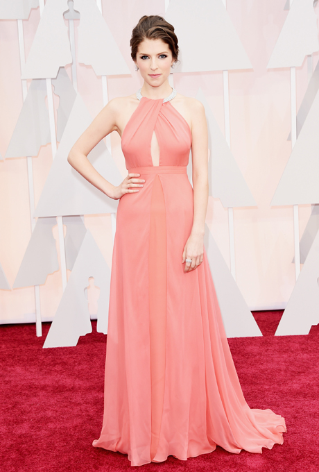 Anna Kendrick in Thakoon: This simple and stunning bold coral gown with chest detailing and jewelled choker is perfect for a romantic and soft wedding. Her gown was paired with a look of smoky eyes and nude lips.