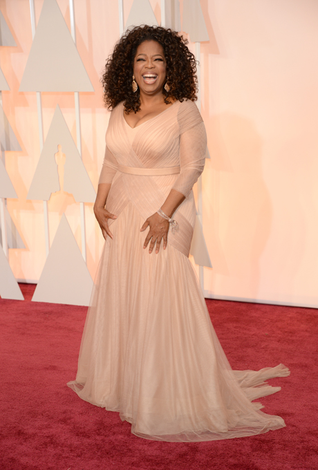 Oprah in Vera Wang:  Oprah looked stunning in the queen of bridal couture's creation Vera Wang. The ivory silk draped elegantly over three-quarter-sleeves and chapel-length train. Whilst this would make a stunning bridal gown, we also think it is absolutely perfect for the mother of the bride!