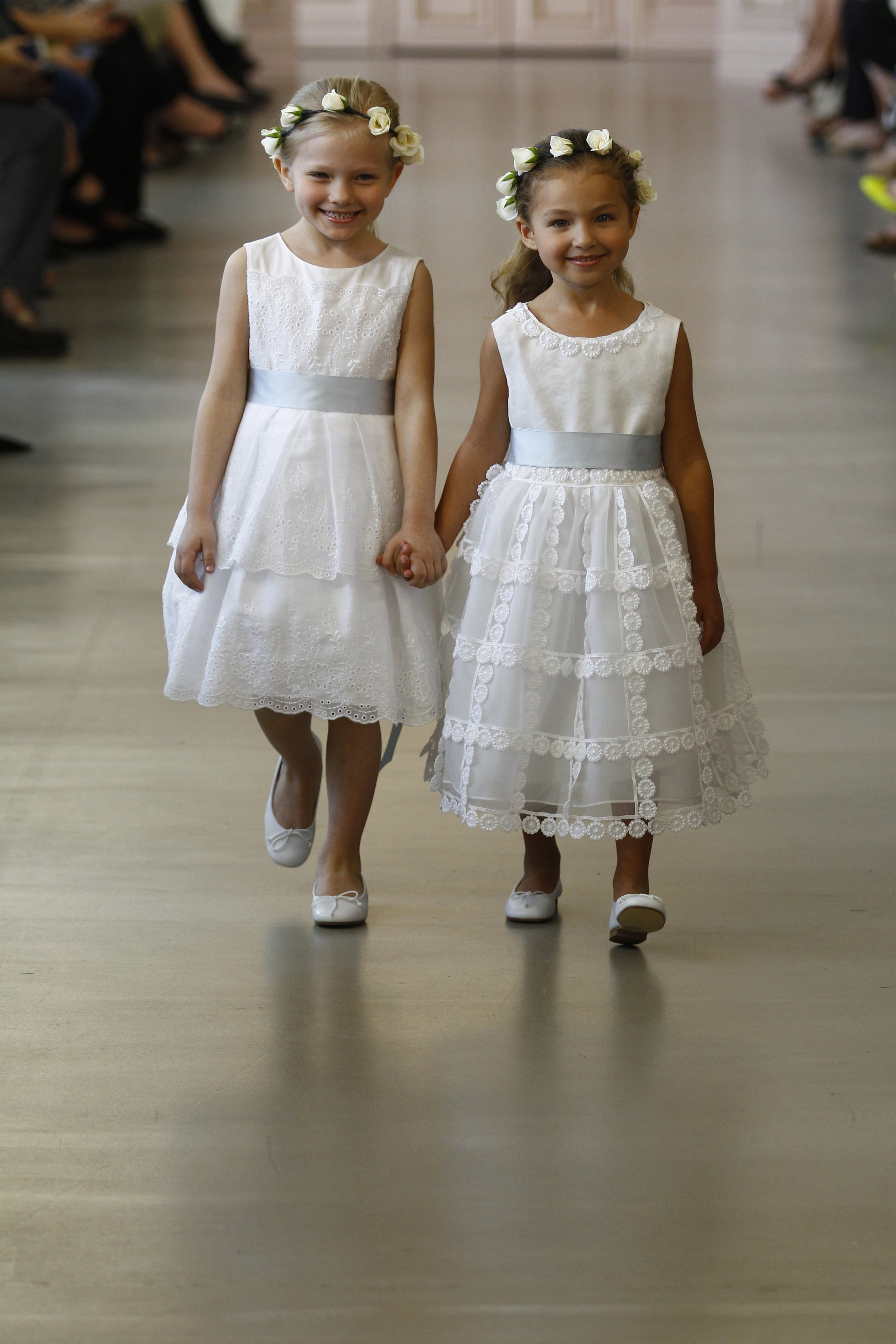 Matilda -White cotton eyelet flower girl dress with pale blue satin ribbon. White leather ballerina shoes.   Milena  -Ivory silk organza flower girl dress with dotted guipure and lace trim. White leather ballerina shoes.