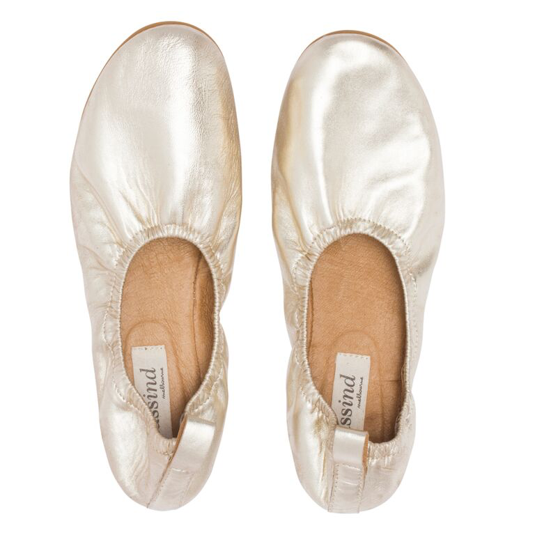 Leather Highline Ballet Slipper in Gold     Ultra soft, super compact and comfortable. Features: padded innersole for added comfort and a finger loop at back to slip on with ease. They are the perfect slippers for traveling. They are versatile and can easily be taken from day into night. You can walk all day in these shoes and honestly forget you even have them on. I always take at least 3 colours of this style with me when I travel.