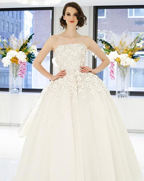 Wedding dress by   Randi Rahm |Photo: Luca Tombolini /  Indigitalimages.com