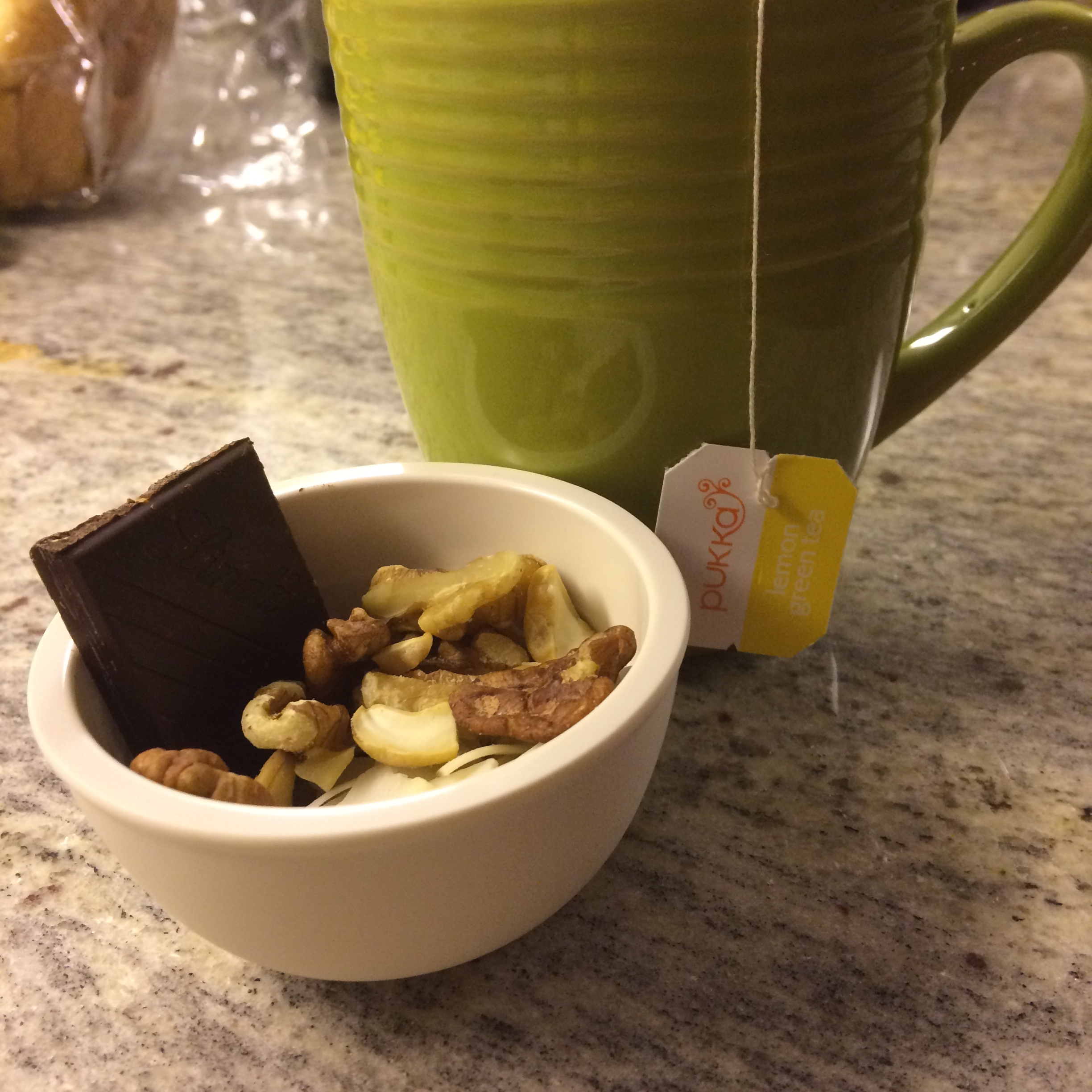 stop feeling guilty for listening to your nighttime hunger! This is my go-to nighttime snack combo:tea + nuts + coconut chips + dark chocolate