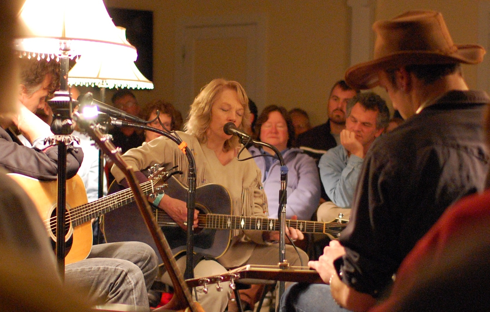 Peggy Atwood, w/ Josh Roy Brown (foreground in cowboy hat playing lap steel guitar) & Robert Burke Warren (left). [photo: Jeanne Hildenbrand]