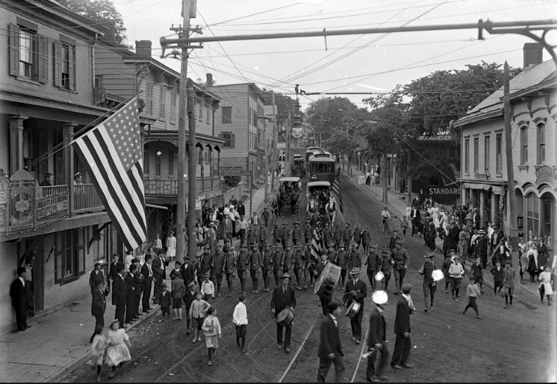 A parade with trolleys on West Main Street, Wappingers Falls, circa 1910. The Central Hotel, later named Ryan's Central House Hotel, is on the left with the flag. Courtesy Wappingers Historical Society.