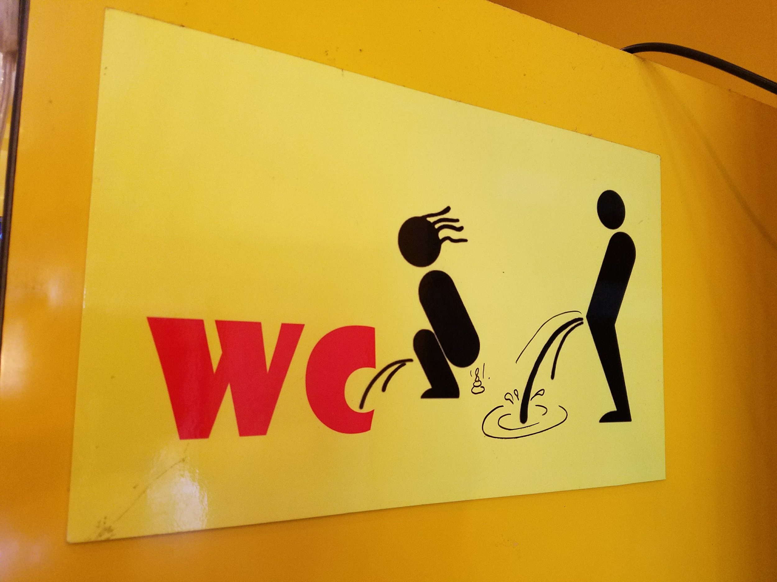 A rare unisex toilet sign in Vietnam