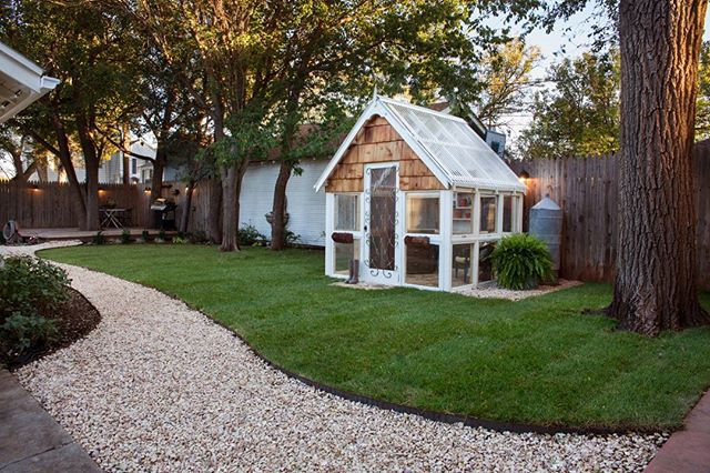 I'm so excited! Our backyard is done! @amarillolandservices did an amazing job! Obsessed with my greenhouse out of our old house windows Adam and I built.