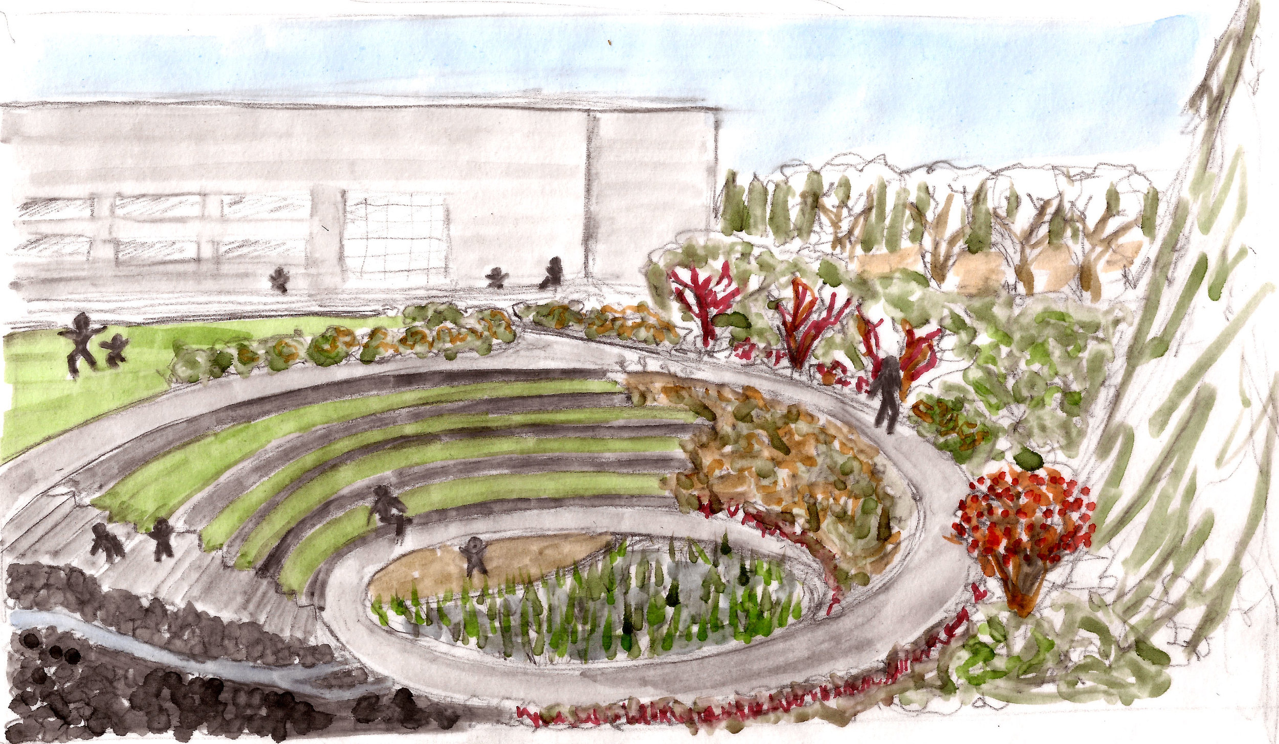 view of amphitheater and stormwater retention pond in winter
