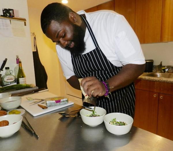 Harris in his food lab garnishing a dish  Photo: Dine Diaspora