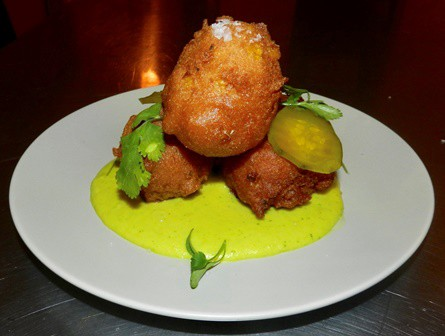 Spicy corn fritters with bread and butter pickles over a cilantro sweet corn puree| Photo: Dine Diaspora