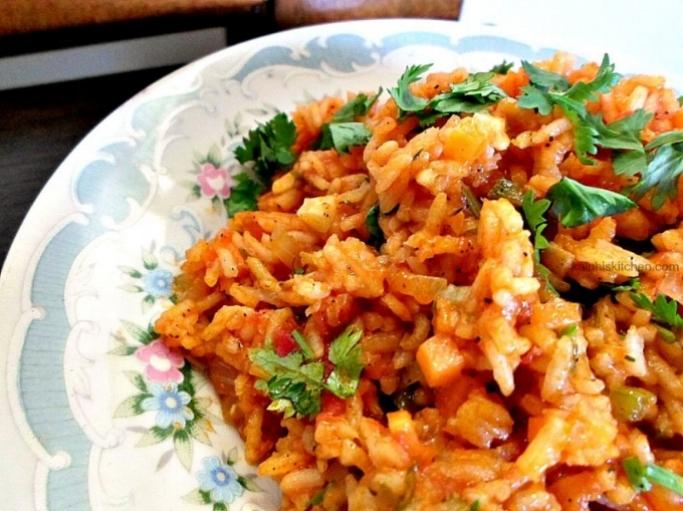 Image:http://www.kaluhiskitchen.com/veggie-jollof-rice/