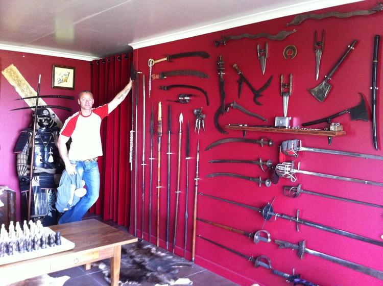Kurt weapons at house.jpg