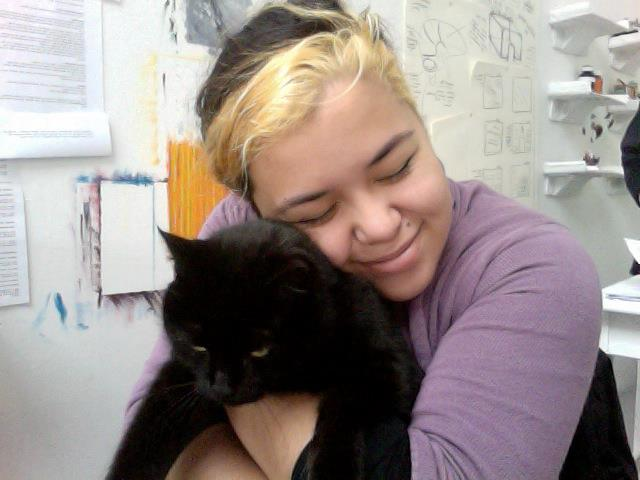 The campus cat and I, sitting behind my studio table. This cat really did love me. Rona's half of our shared wall begins behind me.