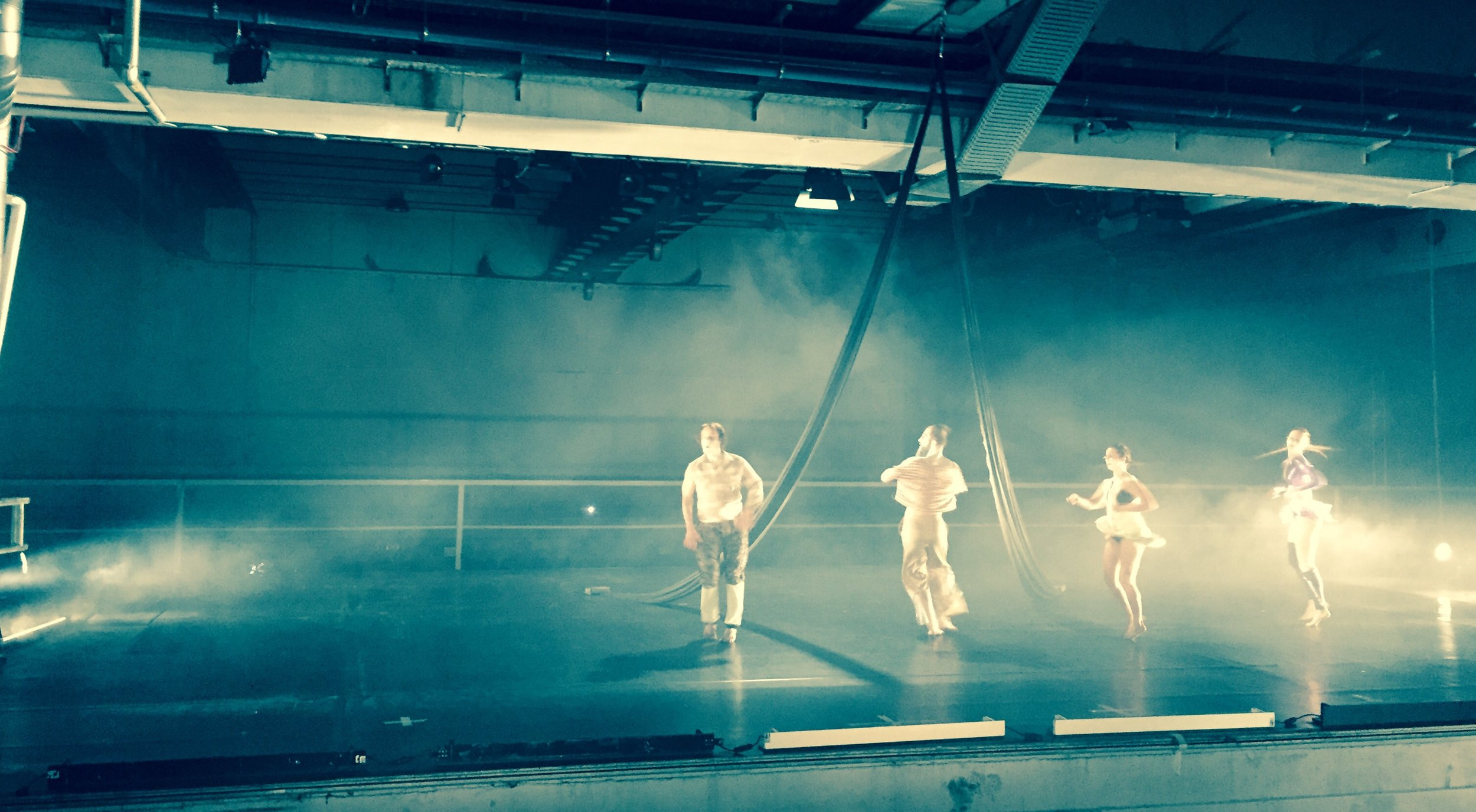 Opening night dancers, with bass speakers in the underground hall that vibrate every atom in you.