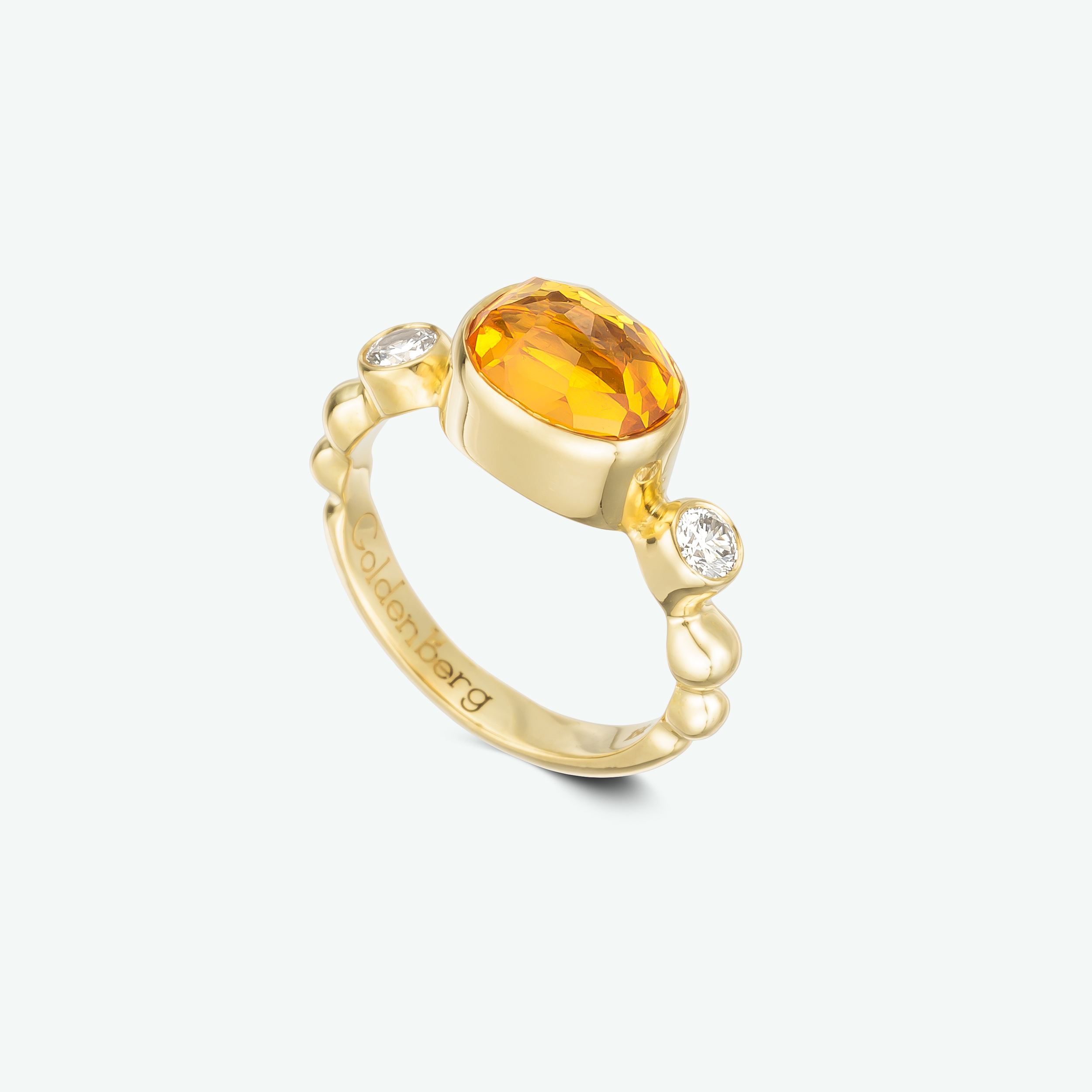 This beautiful ring was made by me and for me. Composed of 18K yellow gold and set with a beautiful spasertite garnet and a golden diamond on each side. D: 0.22 ct.  SG: 2.00 ct.