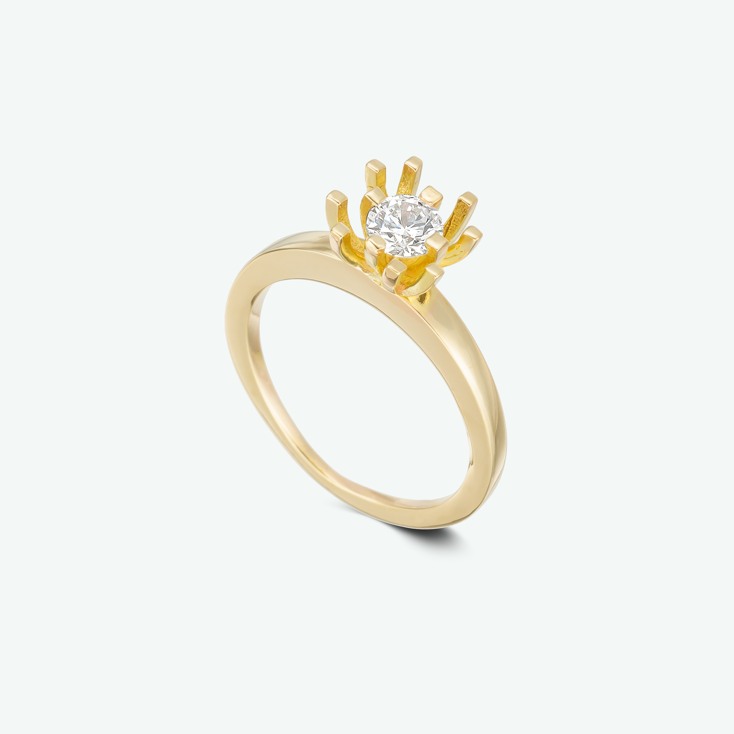 A uniquely designed solitaire engagement ring composed of 14k yellow gold and set with a brilliant diamond. D: 0.30 ct.