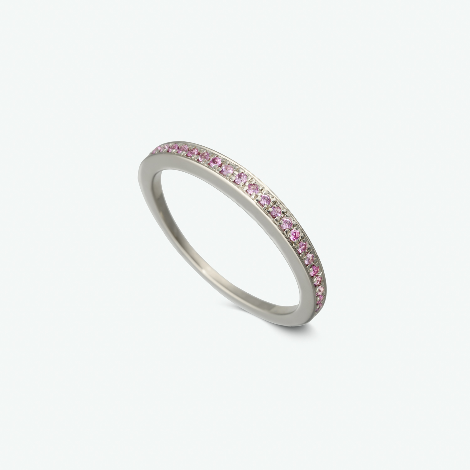 A delicate 14k white gold ring set with vivid pink sapphires.   PS: 0.10 ct