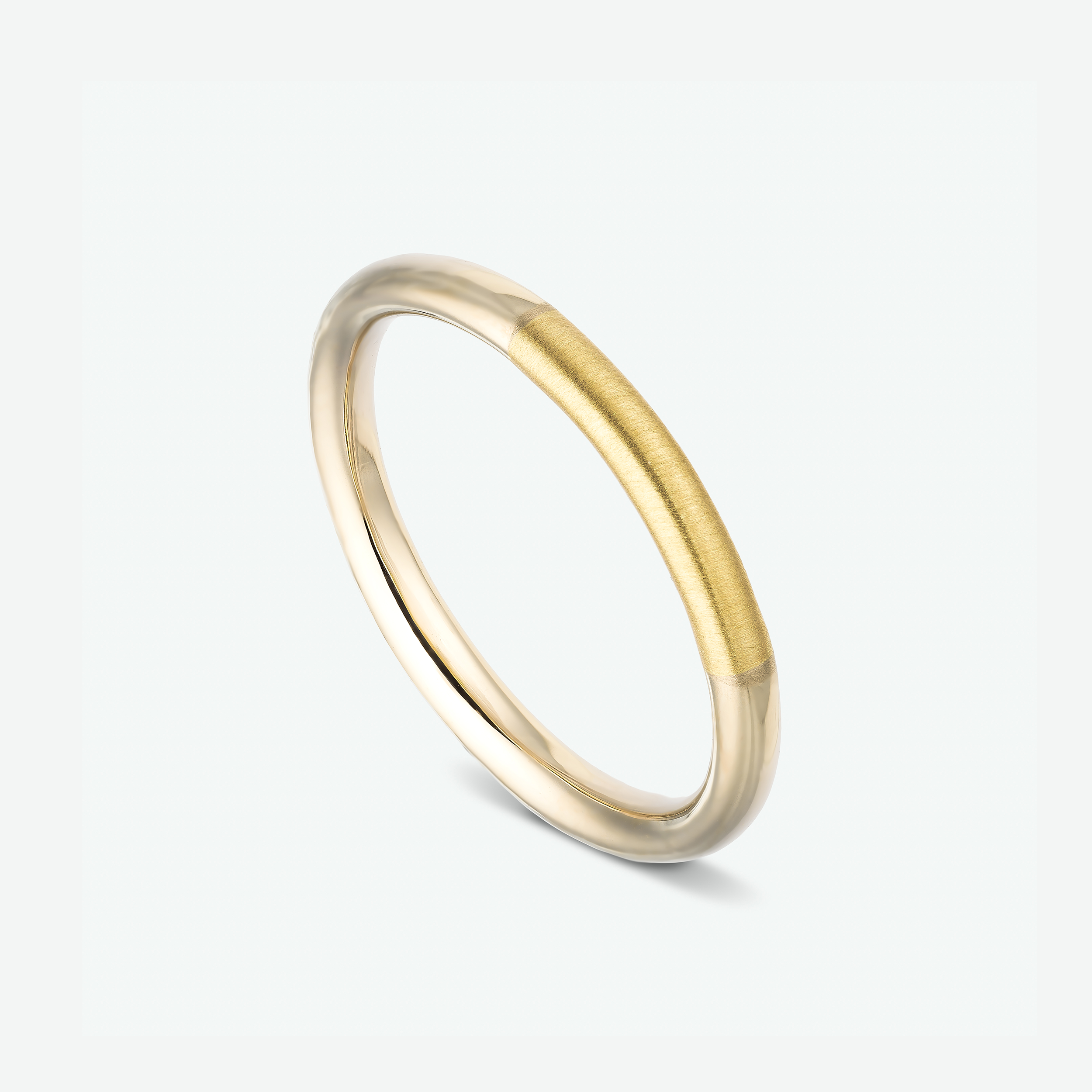 This delicate and unique wedding ring is composed of 14k white and yellow gold, fused together.