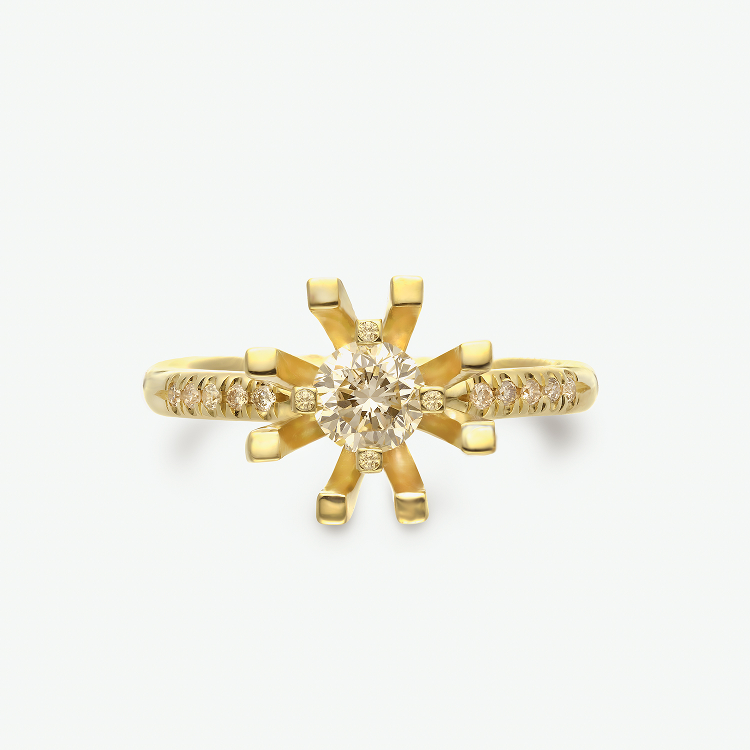 This breathtaking ring is composed of 14k yellow gold and set with champagne and cognac diamonds. CD: 0.40 ct. SD: 0.11 ct