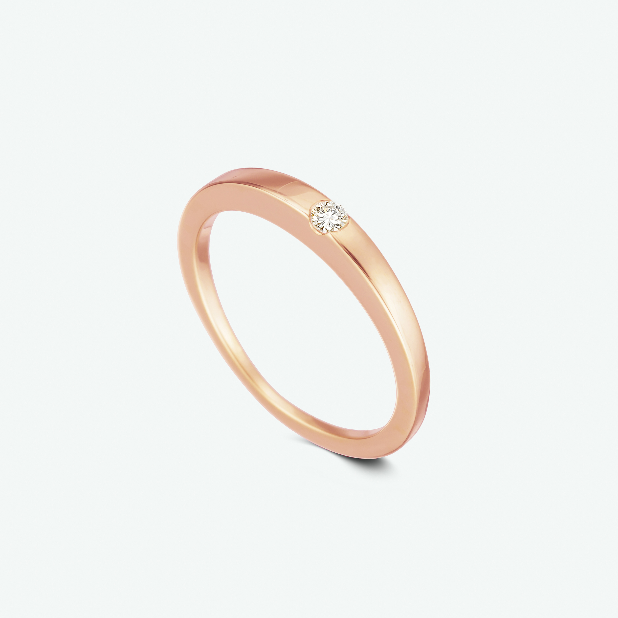 Simple yet luxurious, this elegant and romantic solitaire diamond ring is composed of 14k rose gold, with a uniquely set brilliant diamond.  D: 0.05 ct.