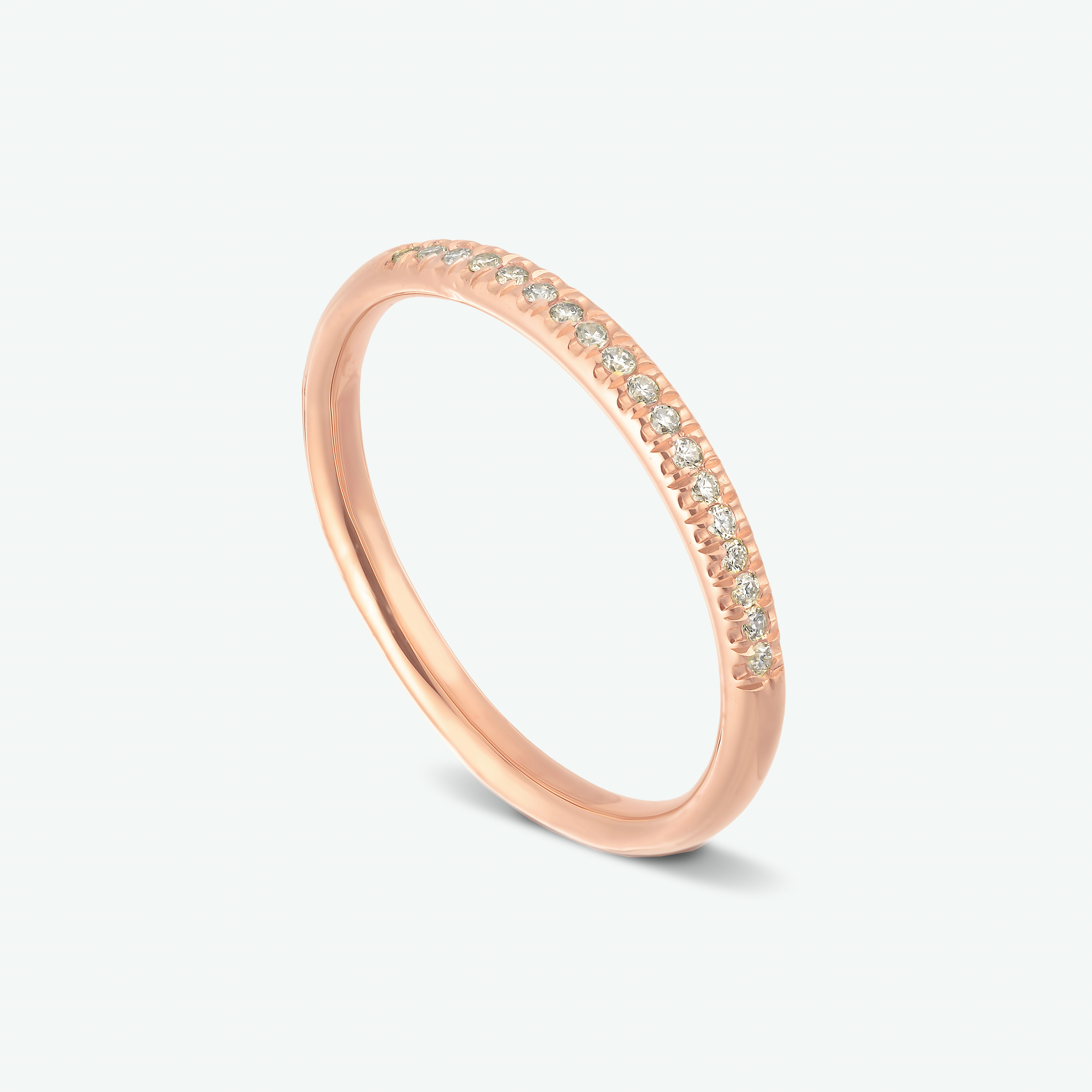 A fine example for a half eternity, pave set, diamond ring. Composed of 14k rose gold that gives this ring it's soft and romantic look.  D: 0.09 ct.
