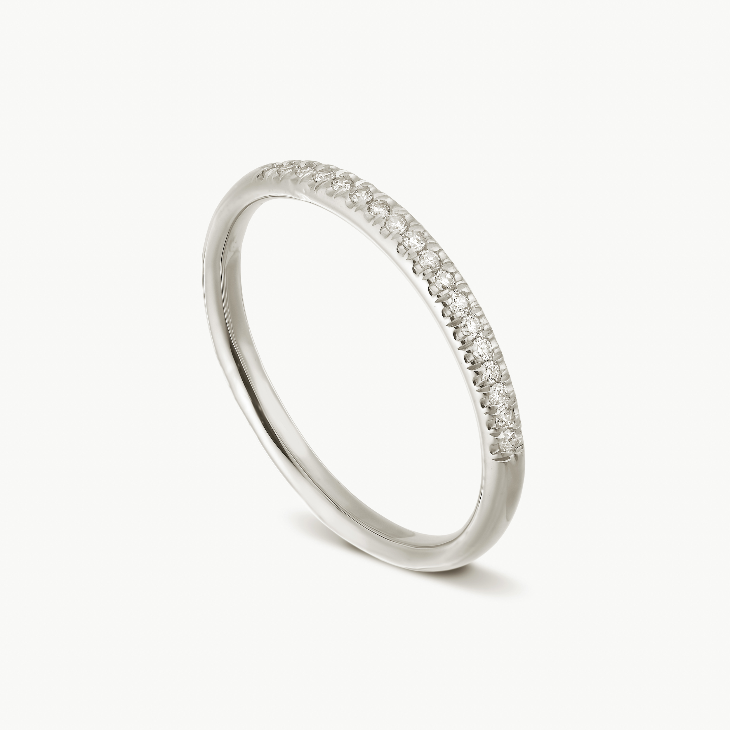 This all time favorite ring in 14k white gold is pave set with brilliant diamonds across it's top.  D: 0.09 ct.