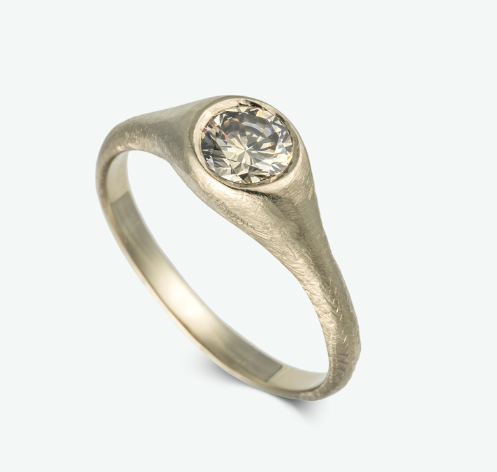 A vintage inspired pearl engagement ring, sparkles beautifully in cognac diamonds and a golden pearl all set in 14k white gold.  CD: 0.11 ct. P: AAA golden japanese pearl 6.5 mm.