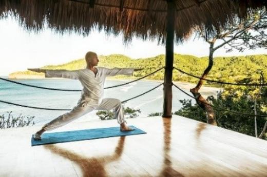 Yoga under a palapa